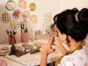 Dom working her ceramics
